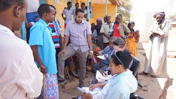 workers from the Bridging the Gap team in Ethiopia visiting potential project beneficiaries