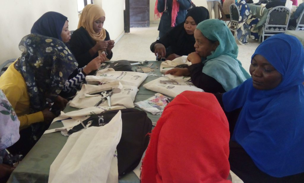 Women with disabilities working in groups during the training