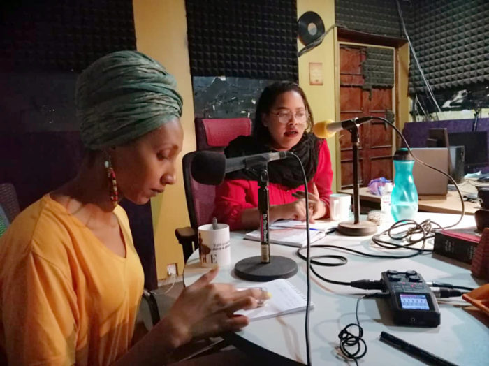 2 women speaking at a radio studio